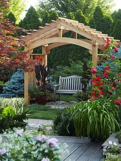 A pergola is adaptable enough that it can be used in a range of structures -- for example, this charming and cheerful seating structure. Used in this way, a pergola adds a focal point to a garden. A few containers help to soften and disguise the structure's base.