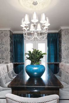 Gray with blue accent... (Light fixture) -*The light fixture and wallpaper together aren't quite right for me....but Love the table & chairs!
