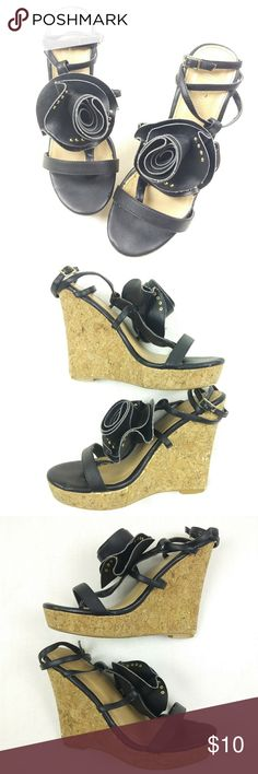 """Colin Stuart black & gold flower wedge sandals 8.5 Beautiful pair of Colin Stuart women's black open toe strap wedge sandals. These sandals feature a black flower with gold studs at the front of each shoe. These sandals are in very good condition and ready to wear.  These sandals are a women's size 8.5B, and the heel is approximately 5"""" high.  Please refer to photos for condition details. Feel free to ask any questions prior to making your purchase. Thanks for looking, and have a blessed…"""