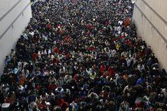 University candidates are lining up to pass the entrance examination for post-graduate study in Hubei province, China. Description from pinterest.com. I searched for this on bing.com/images
