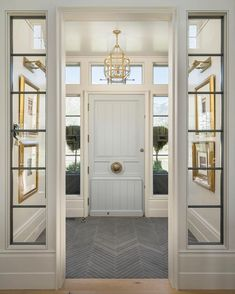 Family Home with Timeless Interiors Foyer Flooring. Foyer with slate floor tile set in herringbone pattern. Foyer opens to living room with wide plank white oak floors. Foyer Flooring, Home, House Styles, Slate Flooring, House Design, New Homes, House Interior, Luxury Homes, Luxury Interior Design