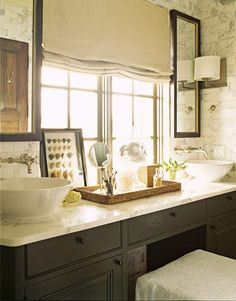 interesting way to handle a large window over the vanity area in a bathroom.