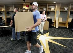 Matt Joyce carries his gear out of the Trop as he prepares for the offseason.