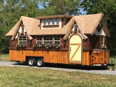 The Highland Tiny Home on wheels with Thatched Roof. By Incredible Tiny Homes.