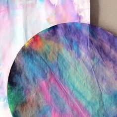 Keep the kids busy with a colorful and easy indoor project using just a few things: washable markers, coffee filters and a wet brush.
