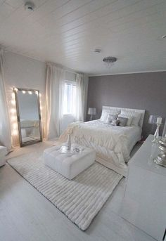 Rug position, soft ambient lighting with mirror, ottoman at end of bed (easy to put fur rugs on)