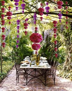 Cascading pom poms, I would get some smaller ones to hang inside.