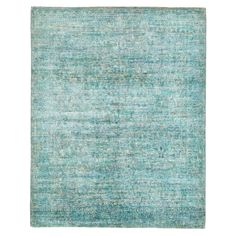 A traditional pattern is faintly visible against a striated blue field in this one-of-a-kind wool rug, intricately handwoven in Pakistan using centuries-old techniques. Harnessing the natural energy of the sun, each rug is organically neutralized from its original color and then overdyed and washed in remarkable chromatic hues to produce a revolutionary work of art.