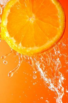 Photo about Orange slice under flowing water - concept of refreshment. Image of refresh, splash, citrus - 2159490 Fruit Photography, Still Photography, Macro Photography, Orange Wallpaper, Cute Wallpaper Backgrounds, Orange Fruit, Orange Slices, Light Orange, Orange Color