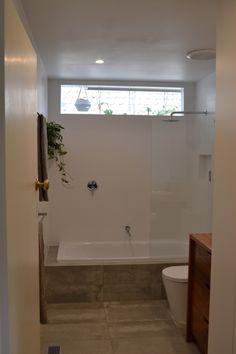 New bathroom with European laundry. Floor tiles are arkitek by Beaumont tiles
