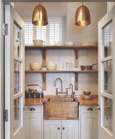 If this nook had matchy-matchy metals, it would not be nearly as fabulous. Notice the door hinges, door knobs, faucet, lighting, sink, hardware, flatware organizer and more!