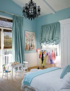 Soooo cute! Love the idea of a chandelier in my little girl's bedroom..- color & clothes rack