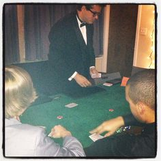 Thompson House: RH Charles dealing Texas Hold Em' to some Thompsonites at the RM casino night!