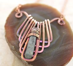 Egyptian design geometrical copper necklace with wrapped organic kyanite stone. $36.00, via Etsy.