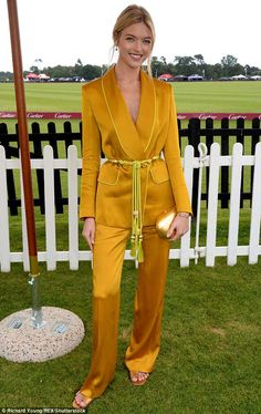 Leading lady: The American beauty, 29, turned the heads of guests in a striking mustard trouser suit as she posed for cameras at the Guards Polo Club