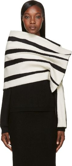Single-sleeve wrap shawl striped in black and white. Unstructured wraparound body with press-stud closure at one shoulder. Fully lined. Tonal stitching.