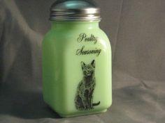 Green Milk Glass Poultry Seasoning Spice Shaker with Cat Caz by Mossopeddler. $17.99. Fired On Decals for Long Lasting. Timeless Sitting Cat Theme. Very charming cottage theme. Great mixing bowls. American Made Glassware. See our entire line of Jade green milk glass, Jadeite, hand made in America. This is a must for the cat lovers in all of us.   Be sure to collect the entire set. We call this our Cazzabella line.  Named for our wonderful russian blue looking cat.  Purcha...