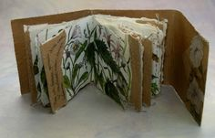 'Bindweed' by Frances Pickering. Book made from brown paper with illustration and stitch by roxycrafts