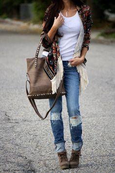 Ripped Jeans. Fringed Open Dark Print Sweater. Wedges. Brown Studded Oversized Bag.