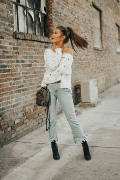 Fringed cropped flare jeans with black ankle boots trend for SS 2018