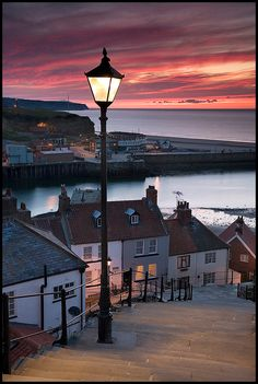 "Sunset over Whitby, Yorkshire, England. Photography by © David Speight Print name: ""View to Whitby Harbour at sunset from the 199 steps leading from The Old Town to St Marys Church and The Abbey North Yorkshire"" Places Around The World, Oh The Places You'll Go, Places To Travel, Places To Visit, Around The Worlds, Beautiful World, Beautiful Places, Yorkshire England, North Yorkshire"