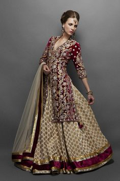 Cream and gold georgette lehenga with a gorgeous deep wine velvet jacket.
