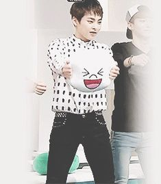 Xiumin is so adorable! >_< i am very disappointed that I can't go squish Xiumin's face right now.