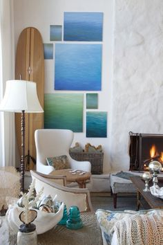 I like the idea of those paintings. Easy DIY, and you could embellish them with beach-sea stuff.