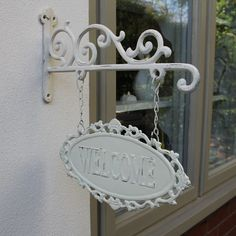 White Metal Outdoor Welcome Sign Wall mountable Ideal for a vintage style garden With scroll and lattice effect For outdoor use www.melodymaison.co.uk