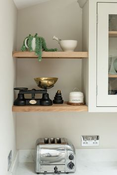 Little nooks can create the perfect spot for a bit of open shelving. Handmade in Oak these shelves create a home for favourite things ~ a pestle & mortar, vintage scales & some greenery. Kitchen Cabinet Makers, Kitchen Storage, Kitchen Cabinets, Oak Shelves, Floating Shelves, Pantry Cupboard, Handmade Kitchens, Bespoke Kitchens, Bespoke Design