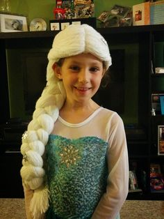 Elsa wig, made with tutorial for the Rapunzel wig I found at: http://thismamamakesstuff.com/2011/10/making-stuff-rapunzel-wig-diy-halloween-costume-tutoria/