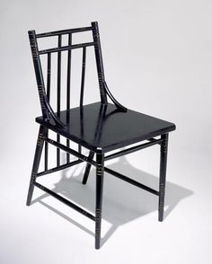 Chair designed by Christopher Dresser and manufactured by Chubb & Co. for the Art Furnishers' Alliance, England, 1880-83. Ebonised & gilded mahogany