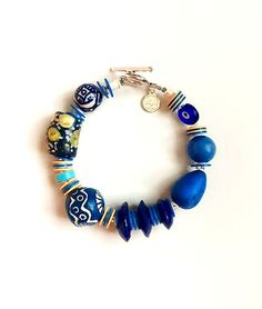The Blue Baubler Bracelet is giving you the Pantone color of A classic blue bracelet with fair-trade African beads and ceramic accents. Pantone Blue, Pantone Color, African Beads, Design Show, Statement Jewelry, Dallas, Classic, Bracelets, Vintage