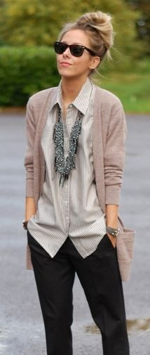 Menswear made feminine with a statement necklace and long cardigan