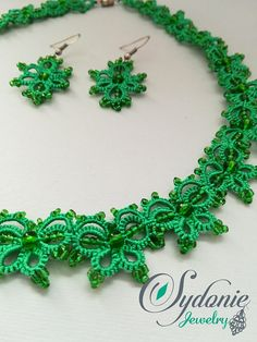 Handmade, unique tatted jewelry. Green silk tread combined with transparent green seed beads make this jewelry an elegant accessory. The pattern imitates small butterflies linked together. Necklace: lenght - 44cm / 17.3 inch, widht - 1.5 cm / 0.6 inch; barrel closure Earrings: lenght