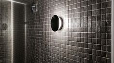 """""""Sleek and Unobtrusive, the iGuzzini TRICK RADIAL creates maximum impact internally or externally.In this bathroom application, it beautifully draws attention to the texture of the tiles by creating a halo effect and subtly washing the surfaces around it."""" http://ladgroup.com.au/2015/03/project-focus-iguzzini-studio-sydney/"""