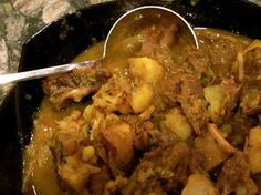 Jamaican Goat Curry (NPR). We made this using our Jamaican Curry Powder and bone-in lamb shoulder rather than goat. The fruity heat of habanero pairs perfectly with the curry flavor. Jamaican Curry Goat, Jamaican Curry Powder, Jamaican Cuisine, Jamaican Dishes, Jamaican Recipes, Curry Recipes, Goat Recipes, Indian Food Recipes, Cooking Recipes