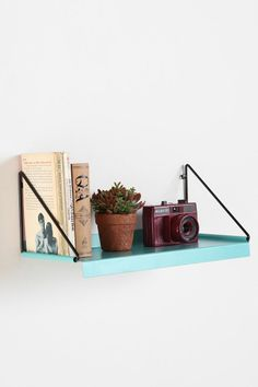 Modern Wall Shelf, these in this color would be fabulous in my kitchen for cookbooks!