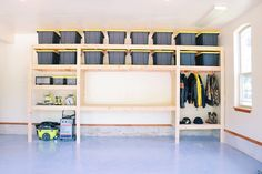DIY Garage Shelves — Modern Builds : The Ultimate Garage Storage / Workbench Solution. By: Mike Montgomery Garage Wall Storage, Garage Organization Tips, Diy Storage Shelves, Garage Storage Solutions, Garage Shelf, Garage House, Diy Garage Work Bench, Building Garage Shelves, Storage Ideas For Garage