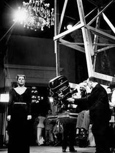 On the set of Notorious, Alfred Hitchcock sets up the shot that goes from a high angle of the party to an extreme close-up of the key hidden in Ingrid Bergman's hand.