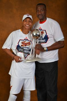 Tamika Catchings and her father Harvey Catchings with the WNBA Championship trophy and MVP award.