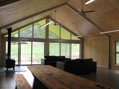 de atelier, plywood ceiling and walls, steel portal frame exposed, ceiling fans