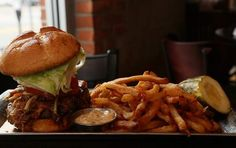 Monk Beer Abbey in Royal Oak features a hand-formed Belgian Blue beef burger with shaved barbecued pork belly, cheddar cheese, apple slaw, iceberg lettuce and heirloom tomatoes. / Mandi Wright/Detroit Free Press