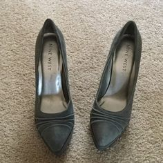 Nine West Grey Suede Shoes 4 inch heel with 1/2 inch platform in front.  Suede upper, rubber outsole, made in China.  Very good condition. There is one tiny dark spot on the front bottom wedge.  Hardly noticeable.  Shown on last picture.  Cushioned insole. Nine West Shoes Heels
