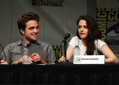 """Robert Pattinson (L) and Kristen Stewart speak at """"The Twilight Saga: Breaking Dawn Part 2"""" Panel during Comic-Con 2012 on July 12, 2012 in San Diego, California.     (Photo by Kevin Winter/Getty Images) 2012 Getty Images"""
