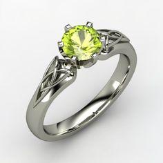 Peridot engagement ring - looks like a LOTR ring!