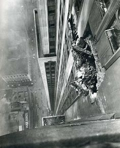A B-25 bomber crashes into the Empire State Building on the morning of July 28, 1945. Photograph by Ernie Sisto.