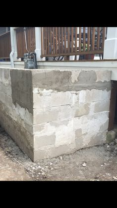 The last concrete block has been set...  The wall structure is complete...