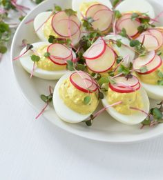 Spring deviled eggs with goat cheese and radish