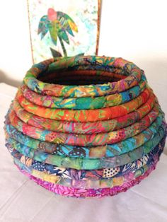 Batik Fabric Coiled Basket Pot by JustJenniferB on Etsy This coiled basket was made with Hoffman's Sunflower batiks and several other Indonesian batiks. The basket is Rope Basket, Basket Weaving, Woven Baskets, Sewing Crafts, Sewing Projects, Fabric Bowls, Rope Crafts, Fabric Art, Etsy Fabric